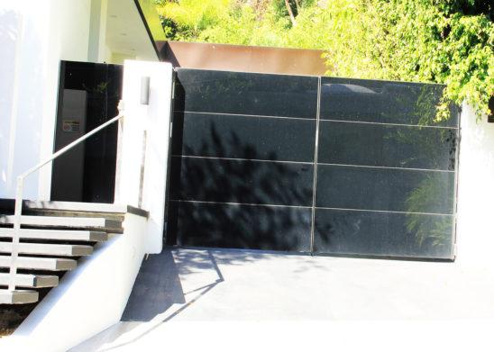 custom contemporary black glass bifold auto gate