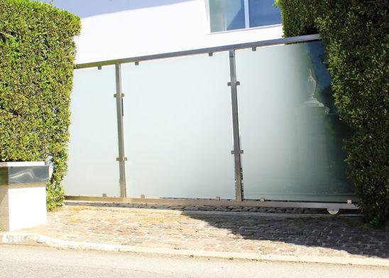 custom hillside installed single slide glass and steel gate