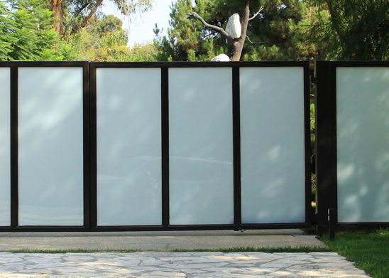 custom steel and vertically arranged glass bifold gate
