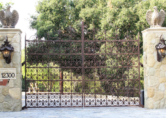 moroccan inspired Rust stained auto bifold gate