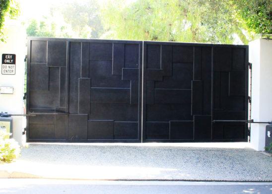 black layered steel auto bifold gate