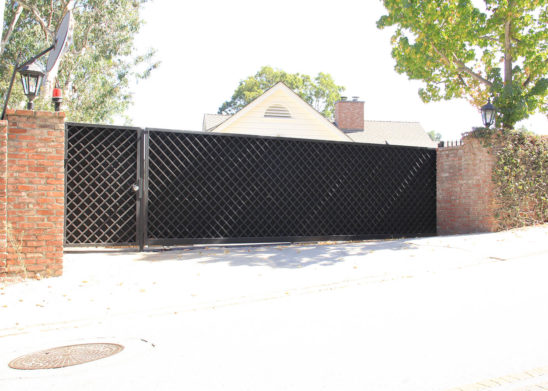 custom built steel lattice sliding auto and pedestrian gates
