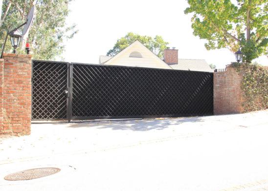 custom built steel lattice sliding auto and pedestrian gates