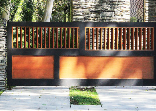 painted and stained wood folding and swinging auto gate