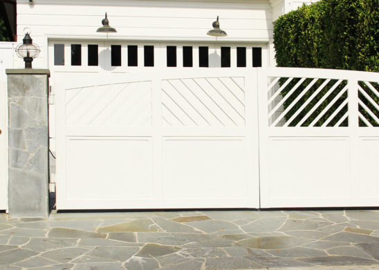 custom contemporary wood bifold auto gate and hinged pedestrian gate