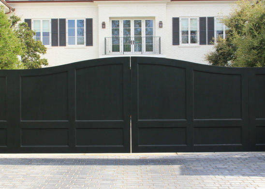 traditional painted wood bifold electric gate