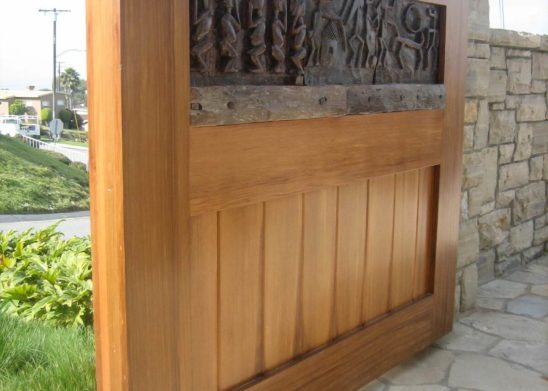 side view custom old world hand carved wood pedestrian gate