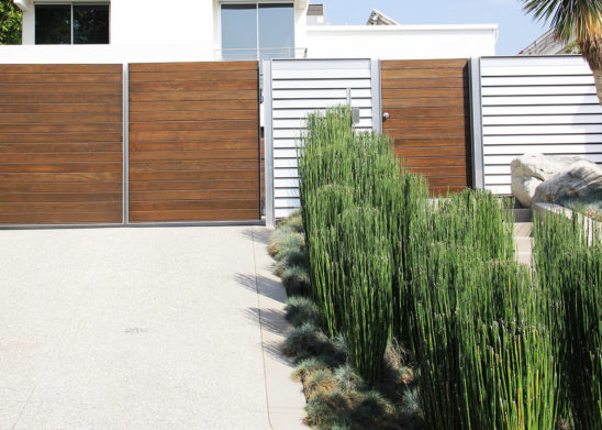 horizontal wood and aluminum bifold auto gate and hinged pedestrian gate
