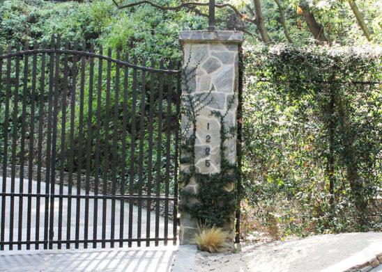 wrought iron bifold auto gate and custom wood pedestrian gate