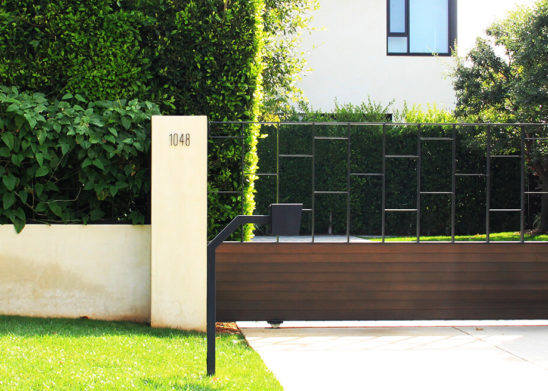 contemporary wood and steel auto sliding gate and hinged pedestrian gate