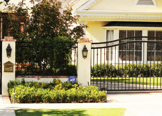 black wrought iron pedestrian and auto gates
