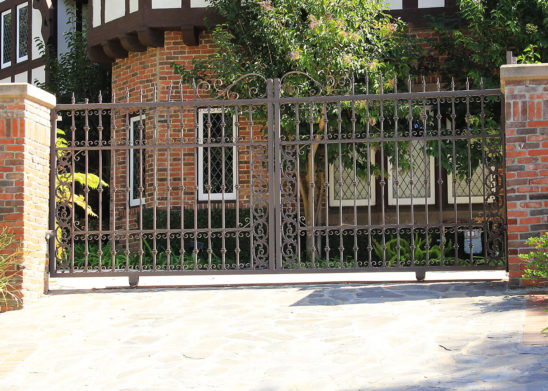 custom dual slide wrought iron gate