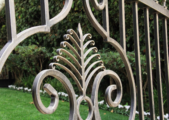 tntricate scroll work on auto wrought iron gate