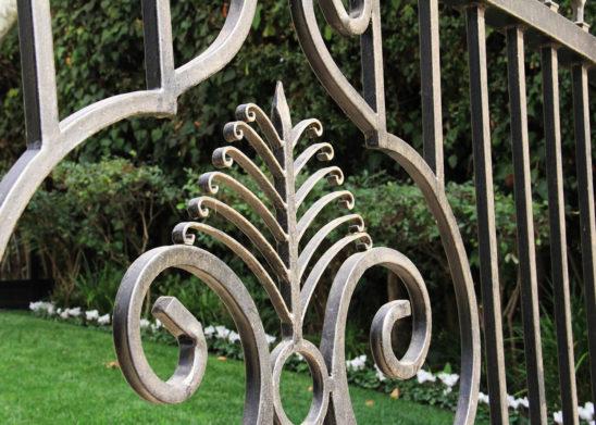 tntricate scroll work on auto wrought iron gate