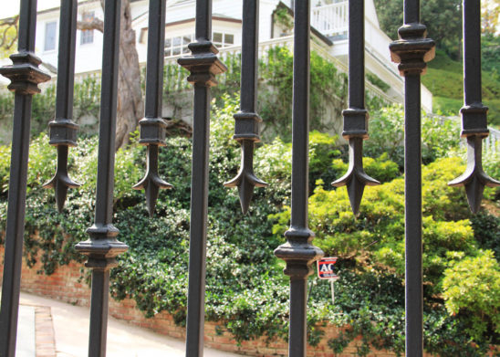 close up of wrought iron gate spindle work