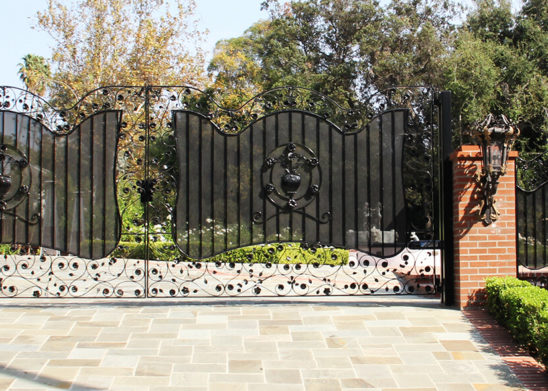 bifold auto wrought iron gate with steel mesh and decorated with handmade flower and leaf appliques