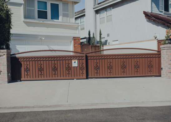 Dual-Steel-Slide-Gates-With-Decorative-Scroll-Work-And-Privacy-Backing Los Angeles, Orange County