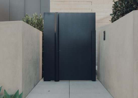 Flush Metal Clad Pedestrian Gate With Concealed Center Pivot Los Angeles Orange County