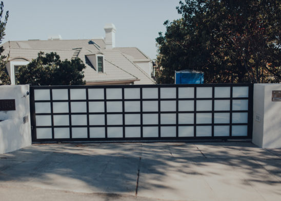 Steel Sliding Gate with Inset White Laminated Glass Panels - Los Angeles, Orange County
